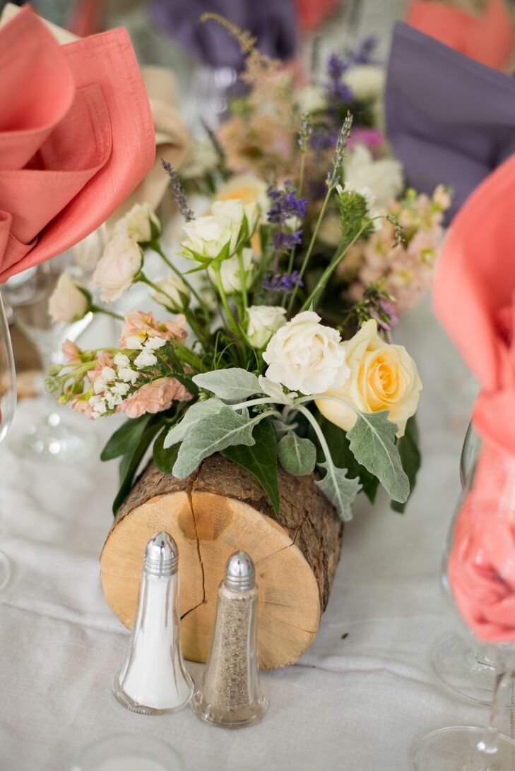 Log centerpieces were filled with cream and white roses, dusty miller, baby's breath, columbine and assorted wildflowers.
