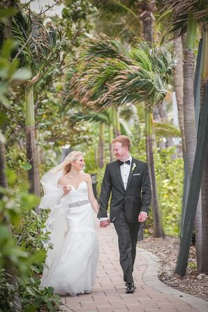 Bride and Groom Walk Along Tropical Venue