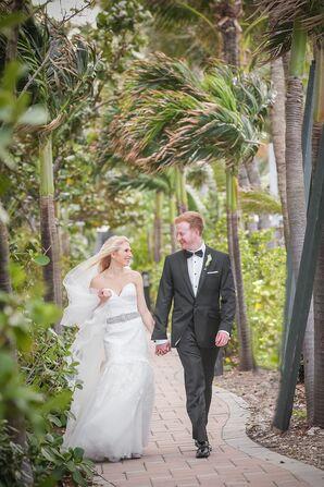 Bride and Groom Walk Along Tropical Venue