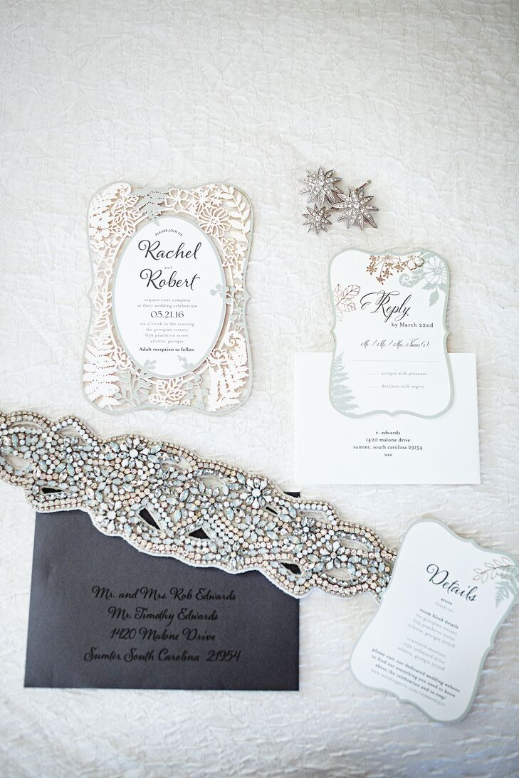 """The couple's ivory invites set the tone for their sophisticated soiree. """"It was just the right fit since we wanted something mystical but not fussy,"""" Rachel says of the laser-cut invites from Wedding Paper Divas. """"Friends and family were definitely surprised."""""""