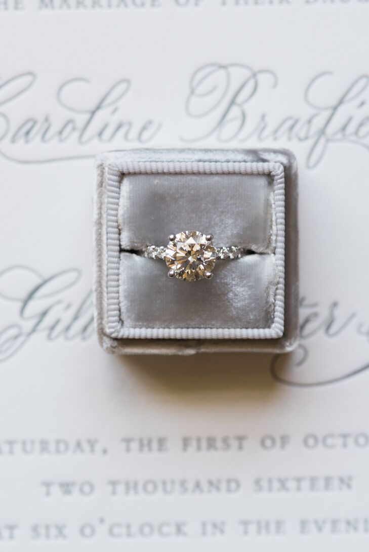 """""""I had a pretty good idea of what I wanted and strongly hinted to Gil that he get some guidance from my best friend,"""" Caroline says of her diamond solitaire ring. """"He took the hint and picked out a beautiful engagement ring for me."""""""