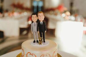 Round Cake with Orange Detailing and Couple Cake Topper