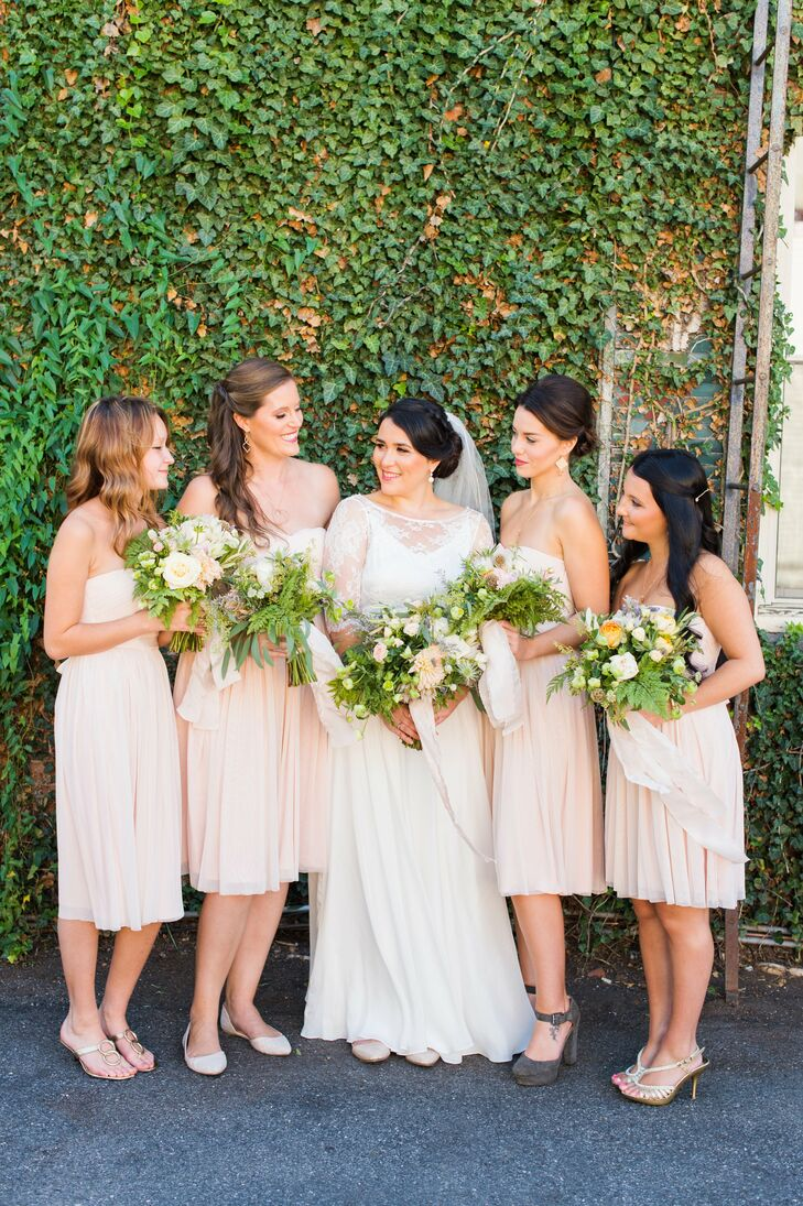 Samantha made things easy for her bridesmaids, who donned matching Cordelia dresses from BHLDN in a soft shade of blush. The midi length and strapless silhouette delivered the perfect balance of effortlessness and elegance. They accessorized the ensembles with their own shoes and jewelry for a personal twist.