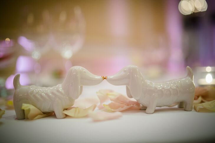 Rebecca and Jonathan incorporated elements throughout the day that spoke to their personalities and backgrounds, adding a personal dimension to the wedding decor. For their sweetheart table, the couple swapped out the standard salt and pepper shakers for white dachshund figurines, a nod to Rebecca's family's dog, Skippy.