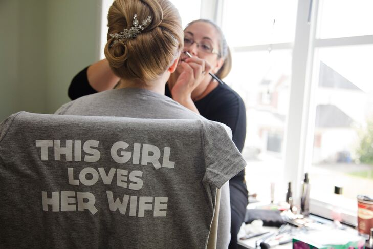 "Stephanie B. had a cute custom shirt that said ""This Girl Loves Her Wife"" for the prep before the wedding."