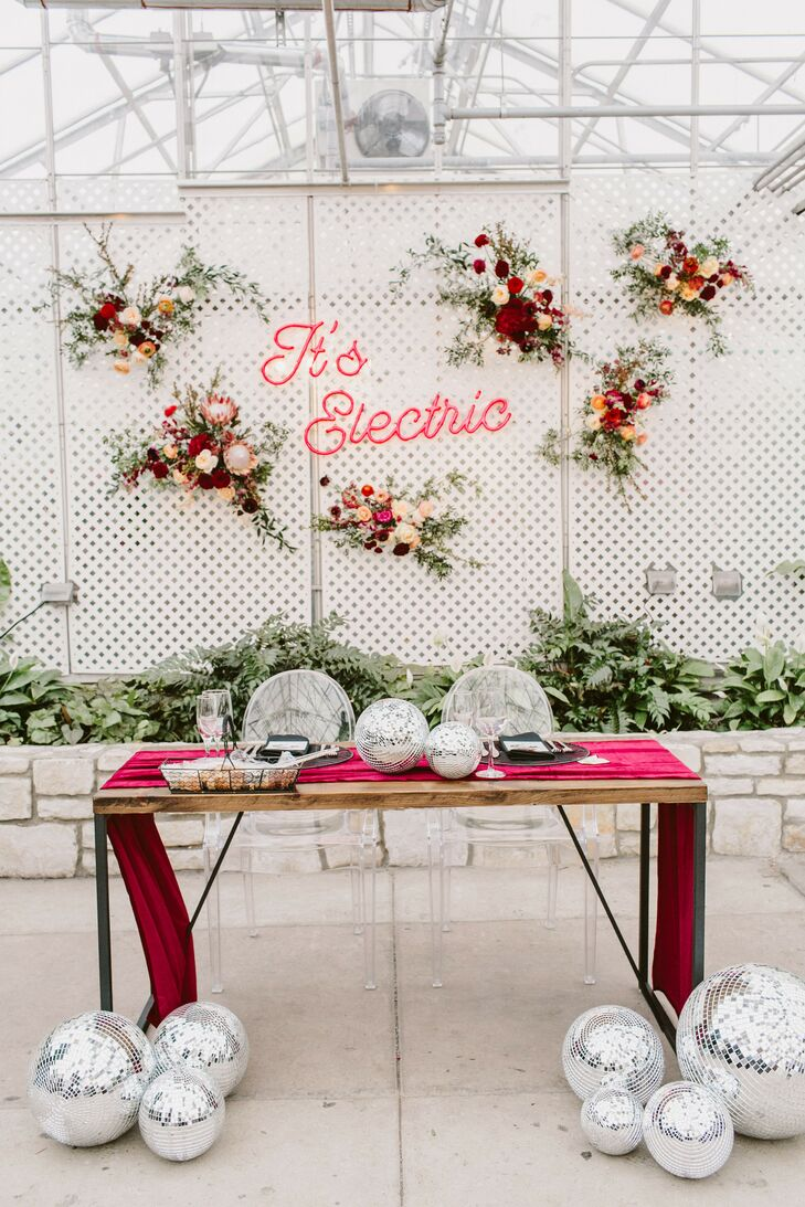 Sweetheart Table with Neon Sign, Disco Balls and Burgundy Table Runner