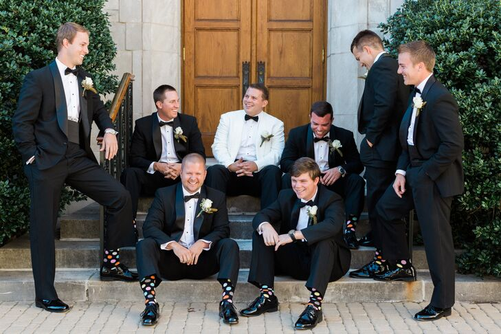 Cameron stood out amongst his dapper groomsmen in an ivory dinner jacket with polka dot socks.