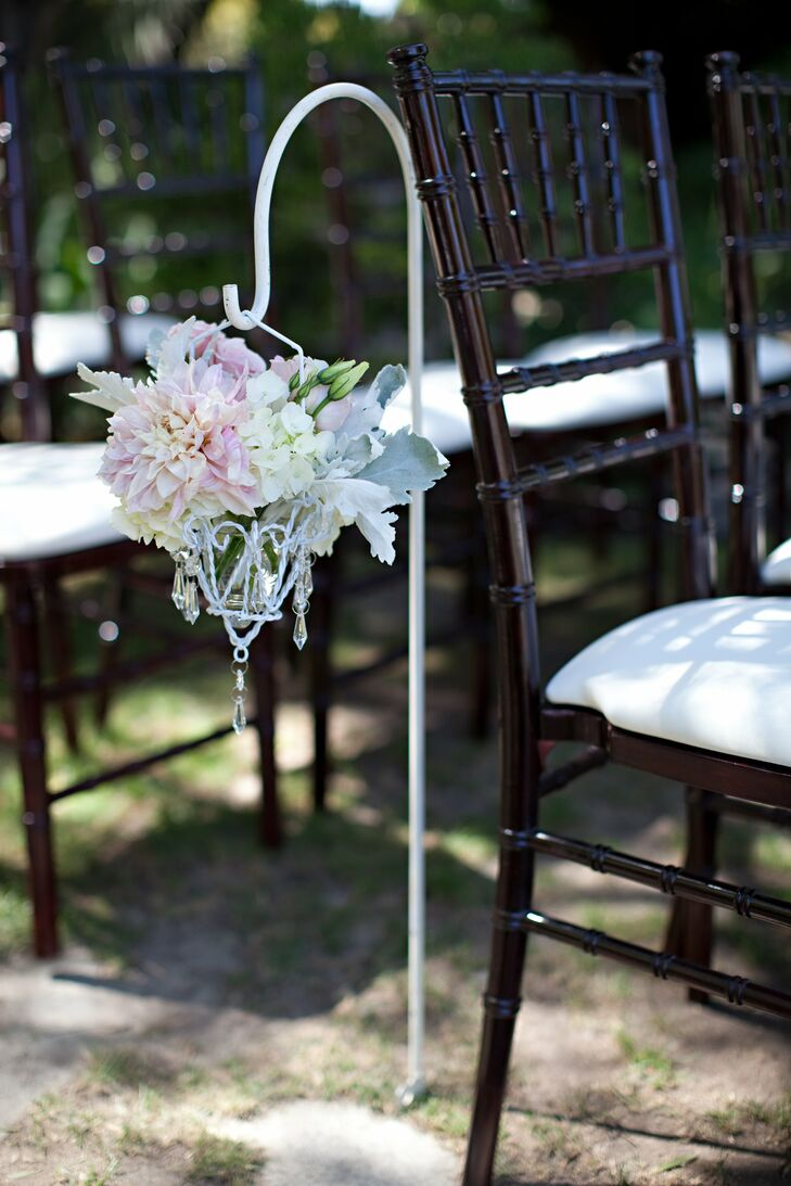 A small arrangement of pink dahlias and white hydrangeas hung next to the ceremony chairs.