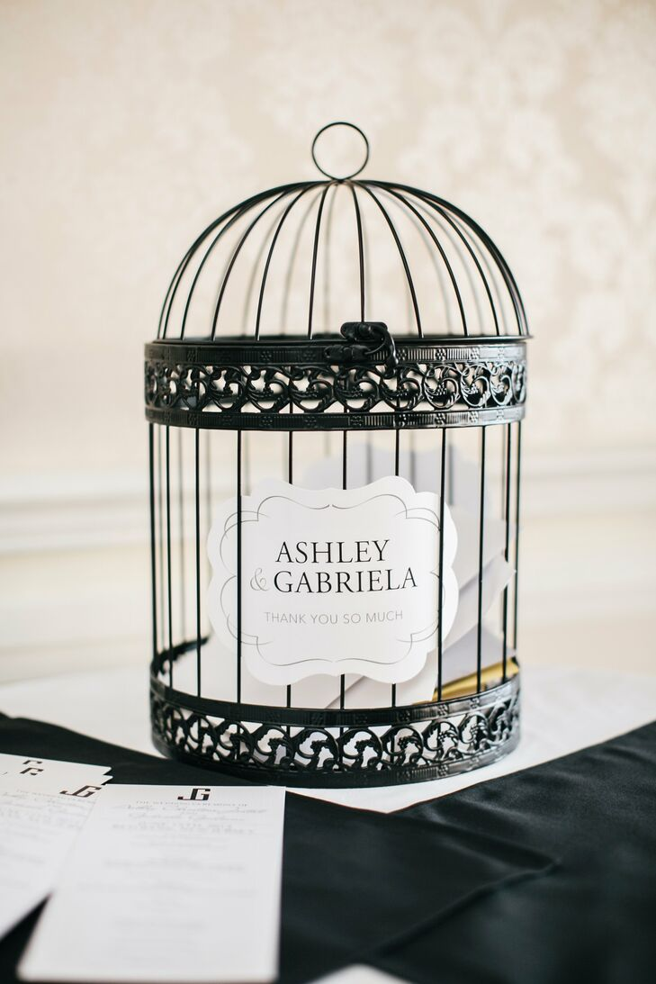 Guests dropped cards into a vintage-inspired birdcage for the newlyweds.