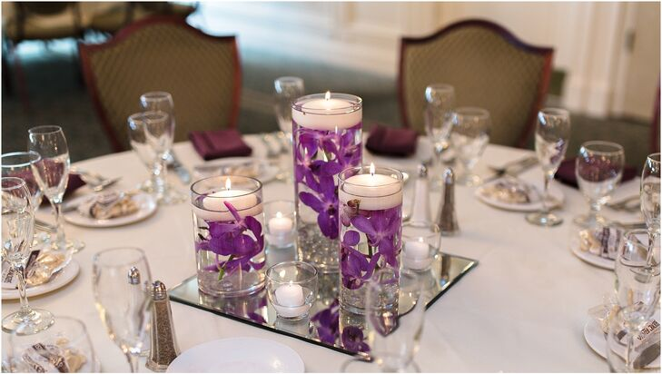 For a sleek, modern feel that still delivered on ambiance, the couple decorated their tables with mirrors and hurricane vases filled with floating candles and bright purple orchids.