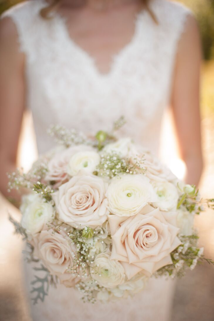 Megan carried a classic bouquet with blush roses, ivory ranunculus, white hydrangeas, baby's breath and dusty miller.