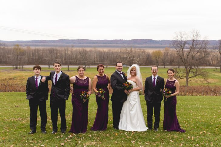 Both Leslie and Roy had six children between them from previous marriages. The couple decided to have only their children as members of their wedding party, making the day a true family affair and highlighting the coming together of the two families. The girls donned floor-length gowns in a deep shade of plum, while the guys sported classic black suits with  ties in the same hue as the girls' dresses.