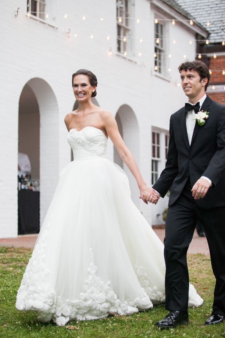 """""""My gown is truly a piece of art, with two layers of gathered tulle underneath a final layer fully hemmed with handmade tulle roses,"""" says Sarah. """"I felt like royalty on my big day!"""""""