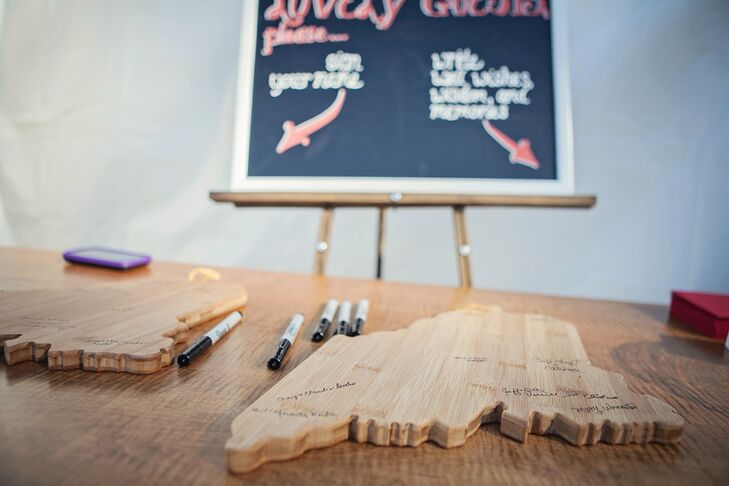 Talitha and Josh chose to stray from the traditional guestbook and have their friends and family sign in on wooden cutouts in the shape of Maine.