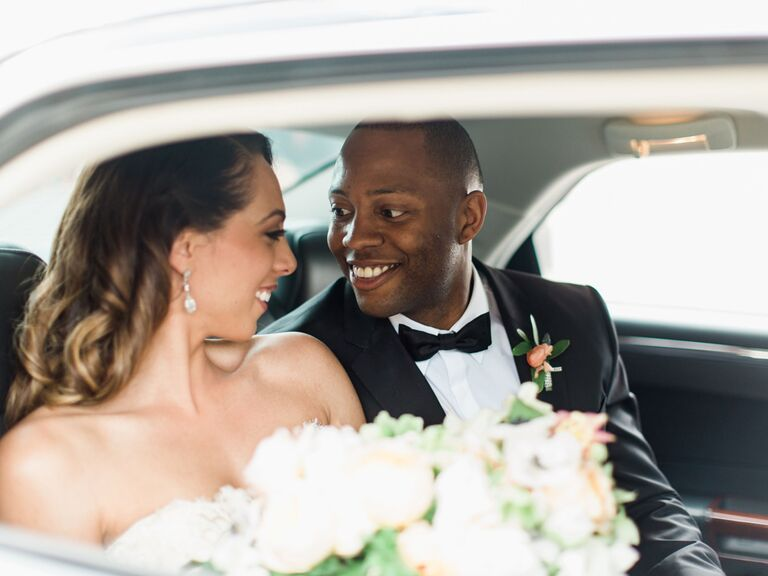 Bride and groom in car after wedding ceremony