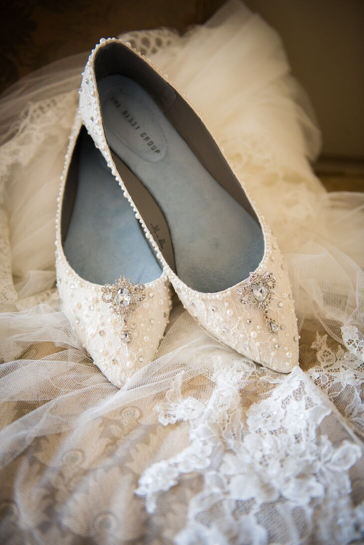 Kelly runs her own Etsy shop, creating handmade, vintage-inspired embroidered bridal and reception decorations. For her own wedding, she resurfaced and embellished her shoes with crystals and beads to match her gown.