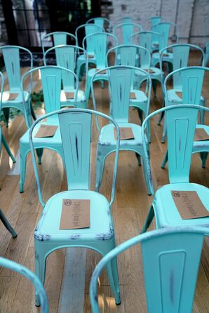 Turquoise Ceremony Chairs with Wedding Programs