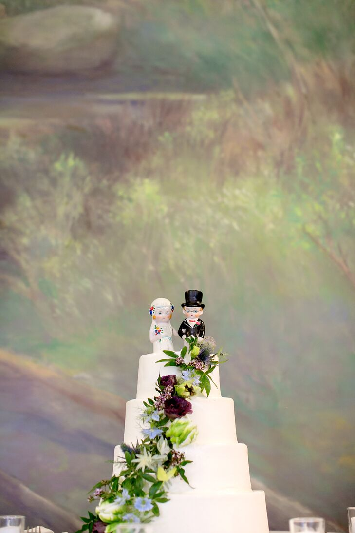 Tiered Wedding Cake with Fresh Flowers and Vintage Porcelain Cake Toppers