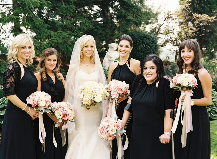 Laura's bridesmaids wore floor-length black chiffon dresses in a style of their choosing.
