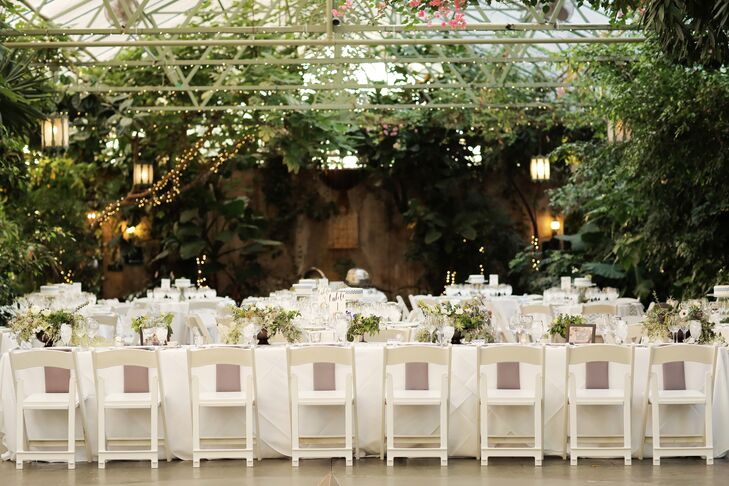 Tables inside the greenhouse (some round, some banquet-style)  were set with fresh white tablecloths and topped with succulents and individual cakes from Salt City Bakery in Utah.