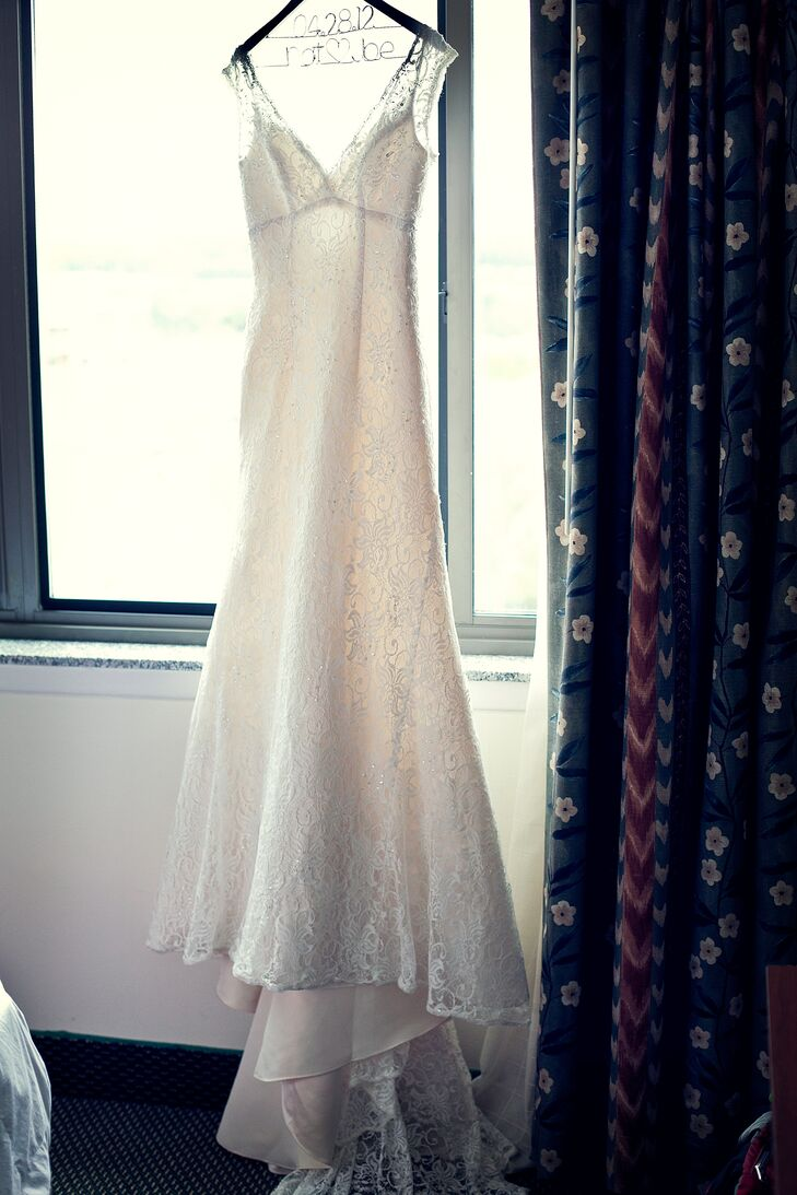 Natalie wore a lace sheath wedding dress with a V neckline and V back, which she bought from David's Bridal.