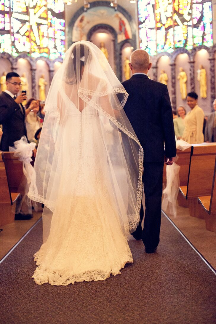 Natalie wore a handmade cathedral veil from Vietnam at her Catholic ceremony, which took place at Queen of Apostles Church in Alexandria, Virginia.