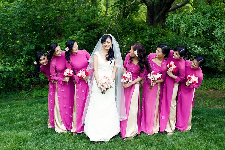 The bridesmaids wore fuschia ao dai, which are traditional Vietnamese outfits. They wore their hair side swept with flowers and carried bouquets of blush and fuschia roses and lilies.