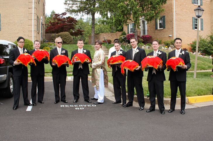 The groomsmen wore traditional black tuxedos, gold ties and white boutonnieres to the wedding. Joe changed into a traditional gold outfit for the Vietnamese tea ceremony.