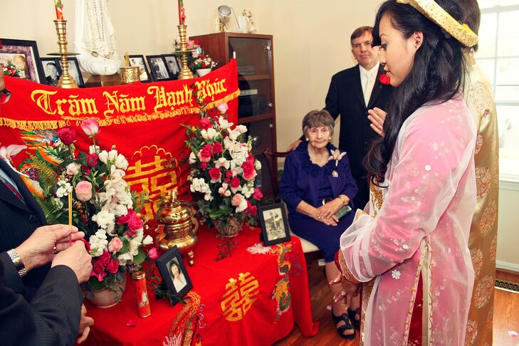 For the Vietnamese ceremony, the wedding party visited Natalie's grandmother's house bearing gifts and asking for the blessing of their ancestors. For this part of the day, Natalie changed into a dark pink ao dai.