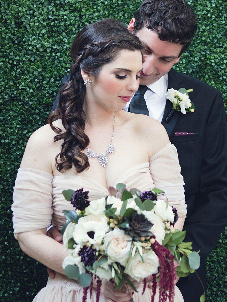 Curled wedding hairstyle with a Dutch braid