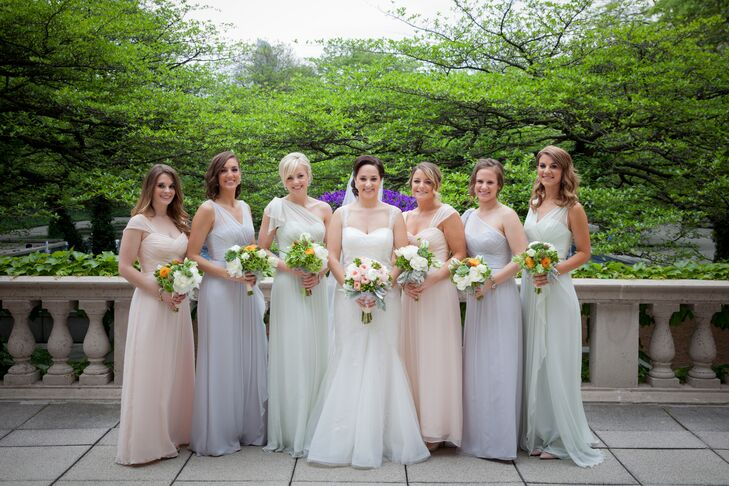 Each of Kelly's bridesmaids donned a floor-length, chiffon Amsale dress in one of three pastel colors: Bellini Pink, Smoky Lavender or Mint Green.