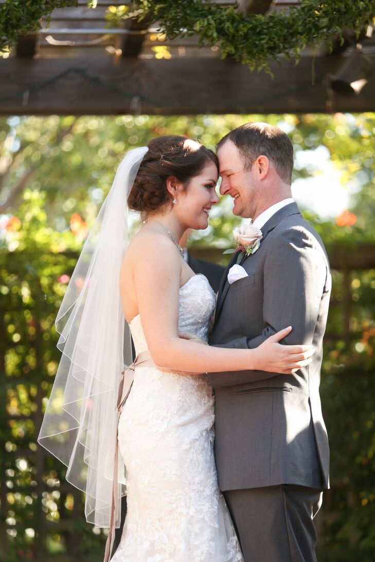 Couple Embrace at Outdoor Wedding Ceremony