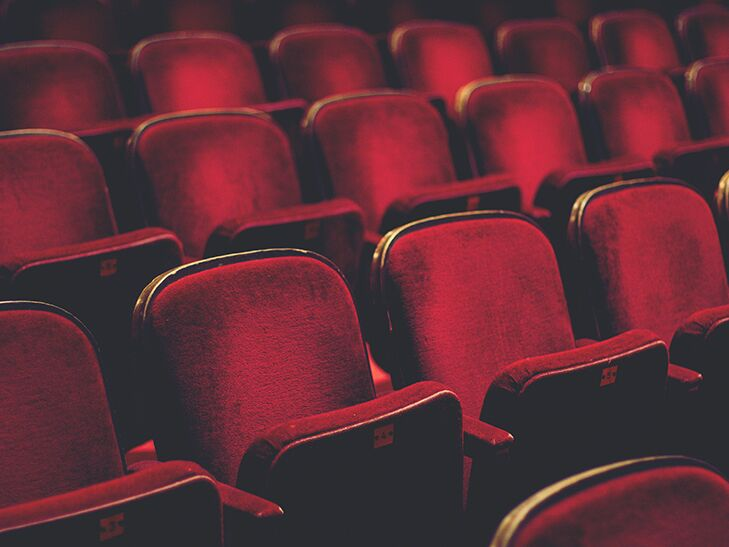 A row of empty theater seats
