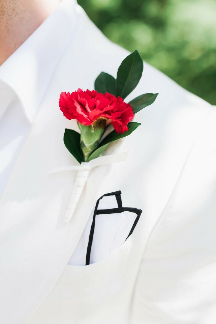 Modern Red Carnation Boutonniere with White Suit Jacket