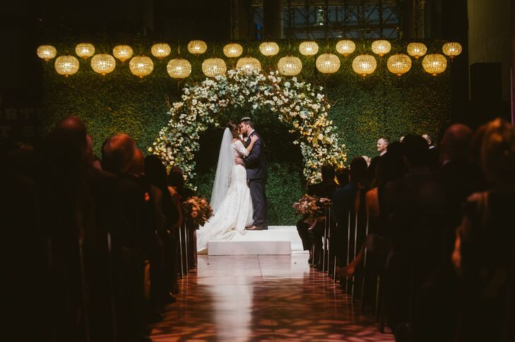 Dramatic Garden-Inspired Wedding Arch and Moss Backdrop