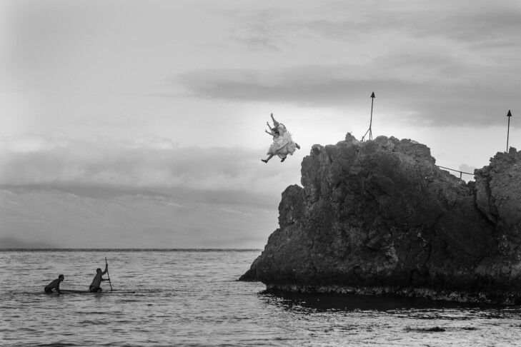 Bride jumping off a cliff in Maui, Hawaii