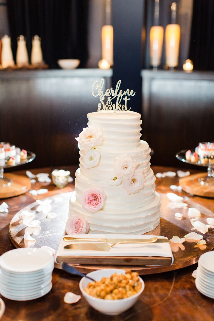 The NoMad Hotel in New York City whipped up a four-tier wedding cake for the couple and their guests to dine on after dinner. Layers of champagne cake with strawberry filling and chocolate cake with Nutella buttercream were decorated with combed white buttercream, blush lisianthus and a whimsical gold cake topper bearing the names of the newlyweds.