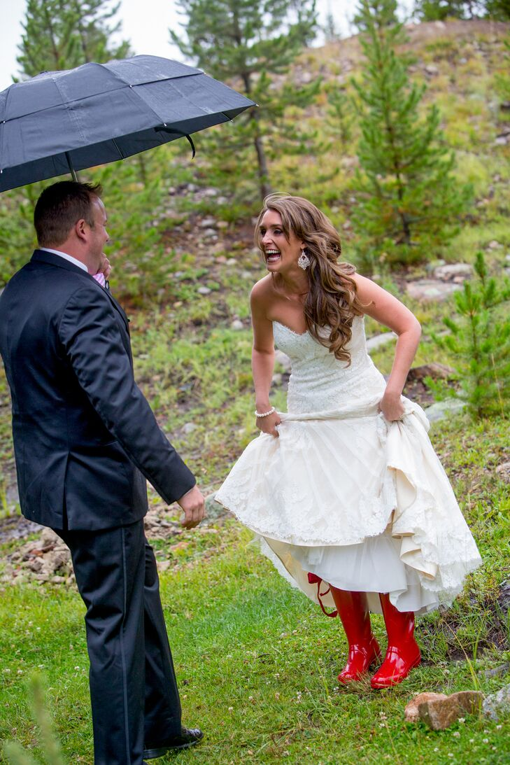 """""""We took first look photos on a private ranch adjacent to Rocky Mountain National Park,"""" Amy says. """"It was pouring down rain, so I wore glossy red Hunter rain boots with red bows under my Matthew Christopher dress."""""""