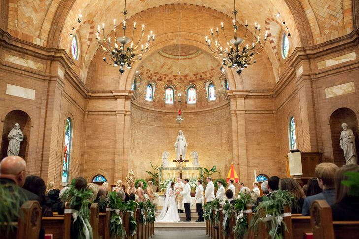 The day started with a traditional Catholic ceremony at Basilica Shrine of St. Mary in downtown Wilmington. The aisles were dotted with lush bunches of greenery, and large urns of full white blooms sat at the altar. A string trio replaced a traditional organ, and a bagpiper played for the newlyweds and their guests as they exited the church.
