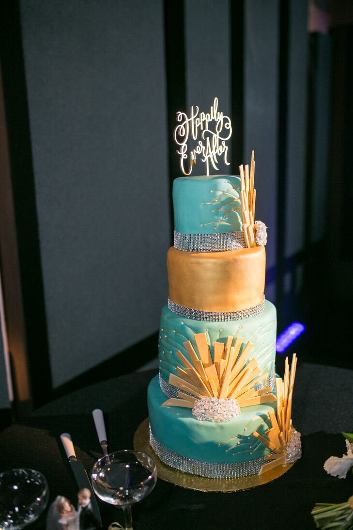 The four-tier gold and mint green cake had alternating tiers of Funfetti and chocolate (Lindsey and Chris's favorites flavors). Gold sunburst motif designs decorated the layers, incorporating some art deco flare into the dessert.
