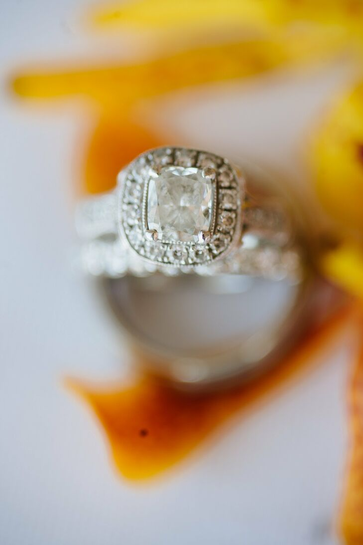 A timeless halo of diamonds surrounded the center stone in Stephanie's engagement ring.