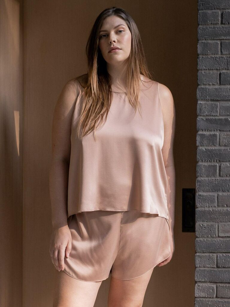 Plus size model wearing washable silk shorts and tank top PJ set