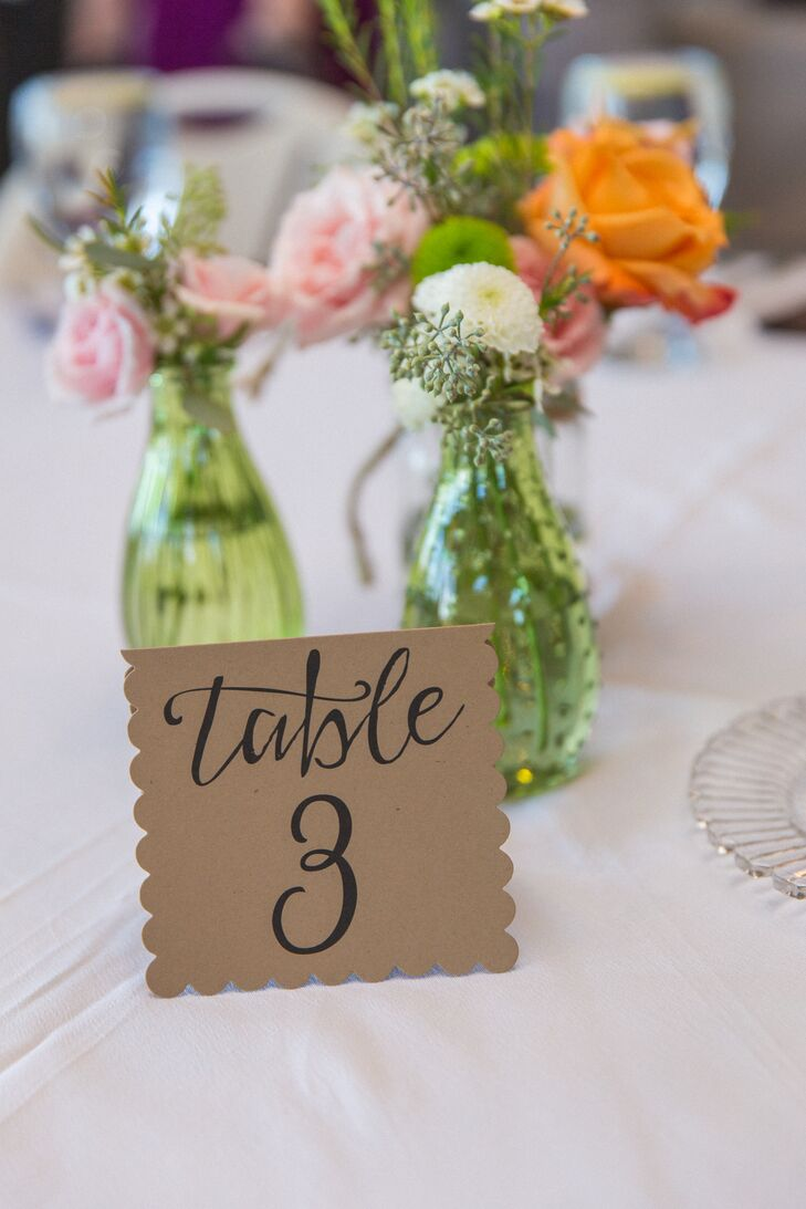 Elegant black calligraphy was done on simple brown paper, which was cut and folded, for the table numbers.