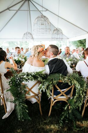 Bohemian Couple with Sweetheart Chairs and Greenery
