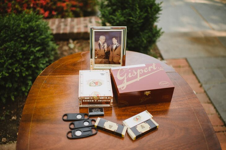 """Mike's father organized a cigar bar with a cigar box and cigars that had been in the family for years, vintage photos of his family members smoking cigars and his  cigar cutter. """"It was a great addition for the guests offering a touch of nostalgia,"""" Beth says."""