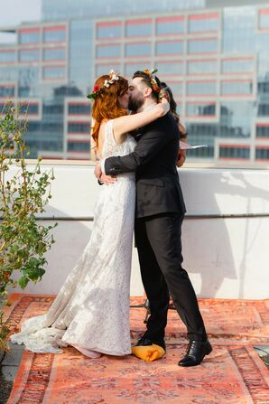 First Kiss at Rooftop Garden Wedding in Brooklyn