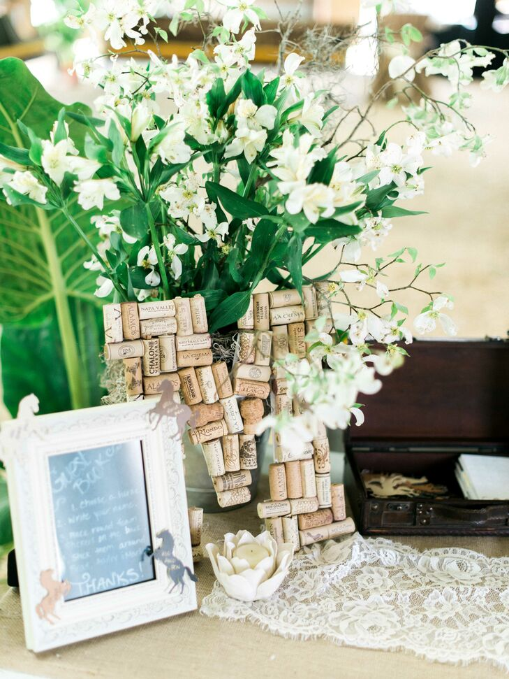 Ashley spent a lot of time and energy creating homemade decorations for the wedding that would accent the rustic farmland while still making it a little bit softer. Their wedding monogram, made of used corks, was placed on a table with small paper cutout horses that the guests used to sign in and send their best wishes.