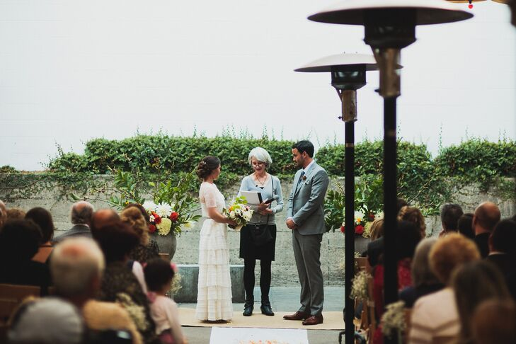 Couple with Officiant at Outdoor Altar