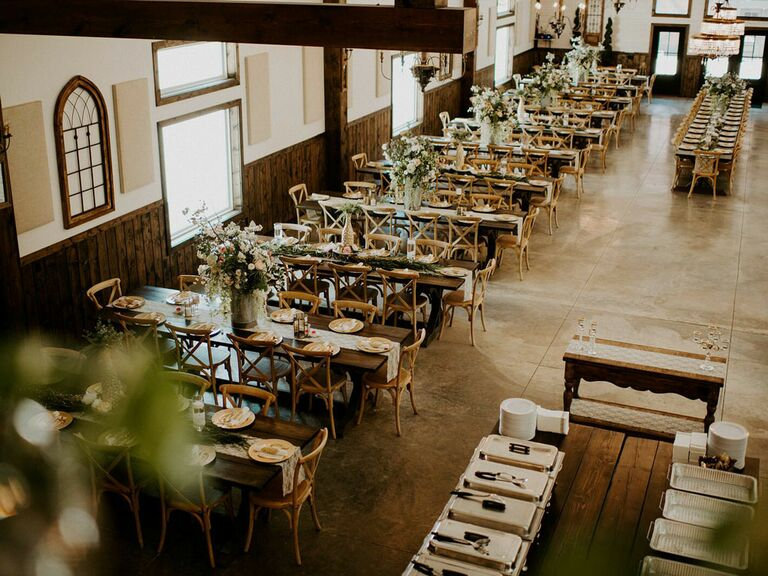 Rustic wedding theme in barn reception venue with exposed wood beams