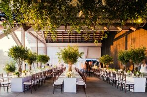 Greenery-Filled Reception with Tall Centerpieces and Hanging Greenery Installation